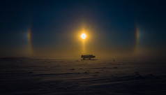 """Tundra Buggy and Sun Dog"" Don Gutoski's snowy view on a photography adventure in Cape Churchill, Manitoba."