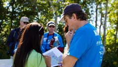 ROM scientist Kevin Seymour looks at a map with the bird team at the 2012 Ontario BioBlitz in Rouge park, deciding where the team will survey