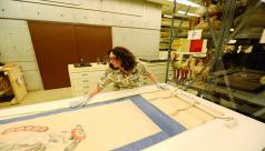 A woman measuring an ancient Japanese print
