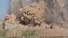 bomb going off in desert.