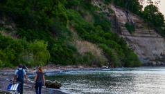 Dr. Burton Lim (left) and ROM Biodiversity's Nicole Richards (right) walk along the Scarborough Bluffs waterfront en route to one of the three bat detectors. Photo by Filip Szafirowski