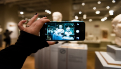 Image of a visitor taking a photo on a smartphone