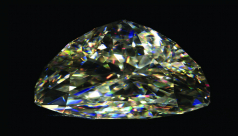 A diamond like gemstone on a black background