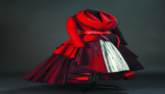 Red dress with white panels and black beaded designs