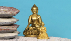 Large and small brass seated Buddha statues.