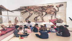 Johnson, a former volunteer an now instructors, teaches his 5 year old class about the Good Mother Lizard Maiasaura.