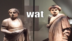 Photo: two Pompeian sculptures making silly faces. Caption: Wat.