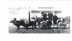 image of workers on a cart