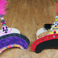 two sample court hats made by students doing the activity