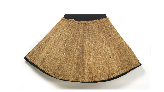 a cone-shaped cape made of bark