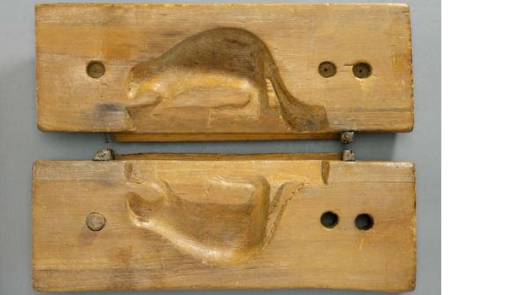 a wooden sugar mould in the shape of a beaver