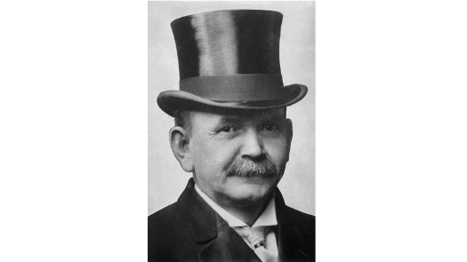 a black and white photo of a man wearing a top hat