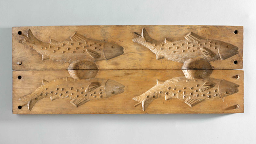 a wooden mould in the shape of a fish