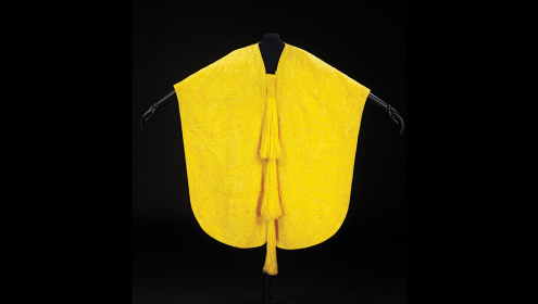 Image of the cape made from golden orb spider silk